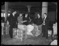 Unidentified men wearing business suits in a cooperative warehouse, Los Angeles, 1930s