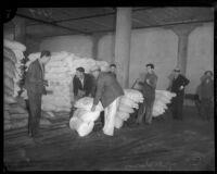 Unidentified men unload bags of Daisy flour, Los Angeles, 1930s