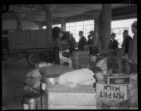 Unidentified men move packaged goods, Los Angeles, 1930s