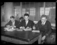Unidentified men work with documents, Los Angeles, 1930s