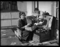 Mrs. Leola Meyers and son go through their belongings after the devestating floods, La Crescenta-Montrose, 1934