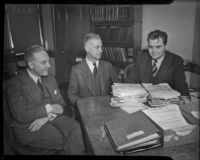 Maj. Donald H. Connolly, C.W.A. director of Los Angeles County, meets with Peirson M. Hall and Capt. Edward Macauley, circa February 1934.