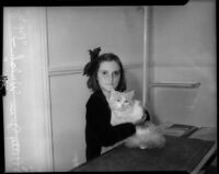 """Pop-eye,"" a brave Persian housecat, and his owner Betty Jean Welch."