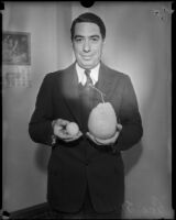 Attorney George Stahlman, photographed holding a Ponderosa lemon.