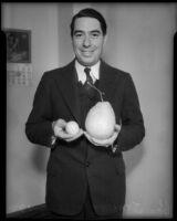 Attorney George Stahlman, photographed holding a Ponderosa lemon.