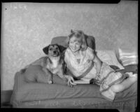 Marie Wright poses with dog Rex, Los Angeles, 1930s