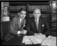 Actor Eddie Cantor and movie mogul Samuel Goldwyn, embroiled in legal suit against Warner Bros.  Circa May, 1934.