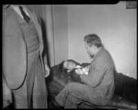 Louis Rude Payne lies on couch, with father Lucius Payne at his side.  June 5, 1934.