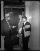 Louis Rude Payne stands with detectives Wallis and Whitehead at his inquest,  June 6, 1934