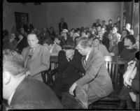 Louis Rude Payne, with father Lucius Payne at his side, at his inquest for the murder of his mother and brother.  June 6, 1934.