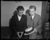Louis Payne sits with father, Lucius F. Payne, on the day of his inquest, Los Angeles, June 6, 1934