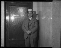 Charles N. Stevens stands before Grand Jury Room, Los Angeles, 1930's