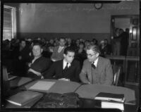 Louis Payne sits with father, Lucius F. Payne, in a courtroom, Los Angeles, June-July, 1934