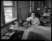 Woman employed by SERA uses sewing machine, Los Angeles, circa 1934