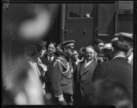 Prince and Princess Kaya of Japan are escorted through a crowd at La Grande Station by Mayor Frank Shaw, Los Angeles, 1934