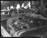 Prince and Princess Kaya of Japan ride in a vehicle through a crowd, Los Angeles, 1934