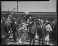 Prince and Princess Kaya of Japan are escorted through a crowd at La Grande Station by Mayor Frank Shaw, Los Angeles, 1934