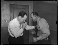 Frank Koehane and Jack Kearns sparring in courtroom, Los Angeles, 1934