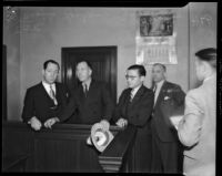 Frank Koehane, Jack Kearns, and various unidentified men in courtroom, Los Angeles, 1934