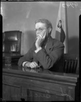 Jury foreman Dr. John P. Buckley at the Los Angeles County Grandy Jury trial for District Attorney Buron Fitts, Los Angeles, 1934