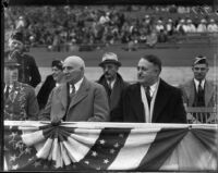 Mayor Shaw and Governor Merriam pose in front of crowd, Los Angeles, between 1933-1939