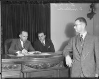 Judges Joseph L. Call and Cecil D. Holland convene in a courtroom, Los Angeles, 1934