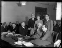 District Attorney Buron Fitts and his sister Mrs. Berthal Gregory appear with their attorneys, Los Angeles, 1934