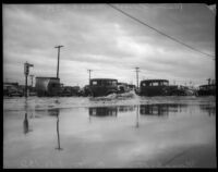 Vehicles cross flood waters at Manchester and Central, Los Angeles, March 1935