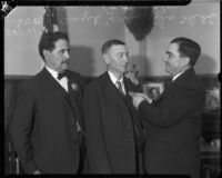 Deputy Sheriffs Yorba and Shehi retire and receive a special badge from Sheriff Eugene W. Biscailuz, Los Angeles, 1934