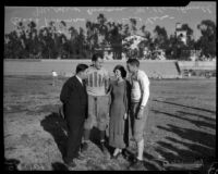 Coach Thomas and Mildred Cowan on football field with Alabama Crimson Tide players Bill Lee and Dixie Howell, Tuscaloosa, 1934-1935