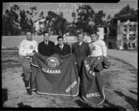 All-American football players Donald Huston and Millard Howell from Alabama pose with coach Frank Thomas, Christy Walsh, and USC coach Howard Jones, Tuscaloosa, 1934-1935