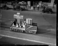 Members of Angelus Temple ride a parade float, Los Angeles, 1935