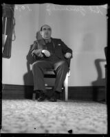 Sol Zemansky waits in a chair at the grand jury trial on gambling conditions, Los Angeles, 1935