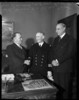 Capt. Yves Donval poses with French Consul Henri Didot and Mayor Frank L. Shaw, Los Angeles, 1935