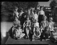 Celia L. Holmes poses with a large group of unidentified children, Los Angeles, 1930's