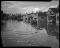 Homes and vehicles submerged in flood waters, Long Beach, 1930s