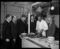 Board of Supervisors meets with local food kitchen chef, Los Angeles, 1934