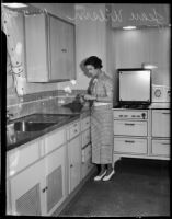 Jean Wilson cooks in kitchen, Los Angeles, 1930s