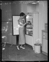 Jean Wilson stores food in refrigerator, Los Angeles, 1930s