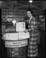 Jean Wilson poses with a block of Switzerland cheese, Los Angeles, 1930s