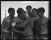 LAJC students gather around unidentified woman after a mud fight, Los Angeles, 1930s
