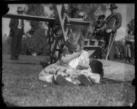 Baby girl eats lunch at annual Iowa Picnic, Los Angeles, 1930s