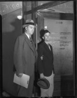 Detective Lieutenant Leroy Sanderson escorts Thomas Edward Dugger who was on trial for the physical and sexual assault of three women, Los Angeles, 1935-1936