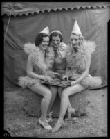 Circus girls laugh over a game of checkers, Los Angeles, 1935