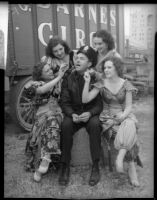 Circus girls tease Officer Ted Stewart, Los Angeles, 1935