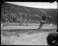 Jesse Owens competes in a long jump event at the Coliseum, Los Angeles, 1935