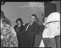 Frank E. Walker, father of murder victim Frances Walker, sits in a crowded room, Los Angeles, 1935
