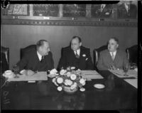 Col. Henry L. Roosevelt speaks with Mayor Frank L. Shaw and Walter J. Braunschweiger at a Chamber of Commerce luncheon, Los Angeles, 1935