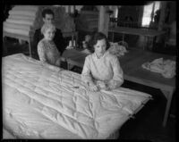 Woman sewing mattress in California State Emergency Relief Administration work program, 1935