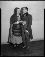 Two opera singers pose for La Boheme at the Shrine Auditorium, Los Angeles, 1935